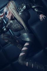 Blond woman in steel armor posing