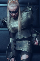 Blond woman in steel armor posing