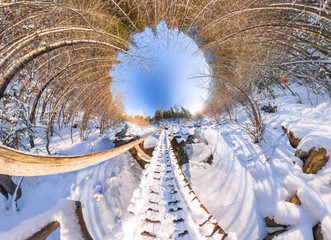 Spherical panorama 360 wooden bridge over a river in the winter