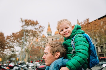 father and little son travel in Barcelona, Spain