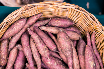 Top view of Fresh yams in basket