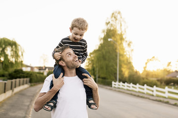 Man carrying son on shoulders