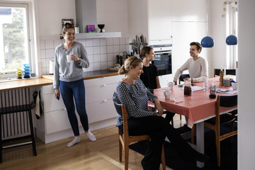 Happy family spending leisure time in kitchen of new home