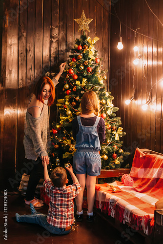 Colorful Christmas Background For Kids.Festive Interior Beautiful Background Mom With Kids Dress