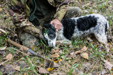 Man and dog hunting for black truffle in the woods of Tuscany, S