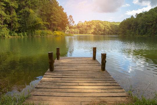 beautiful scenery - wooden dock beside lake.