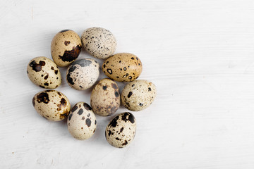 Food: group of quail eggs and egg, isolated on white background