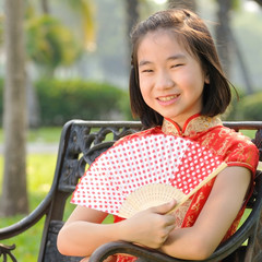 12 years old Asian girl in red Chinese new year Dress post profi