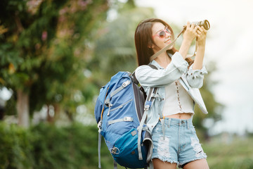 Beautiful Asia woman traveler with camera,travel concept