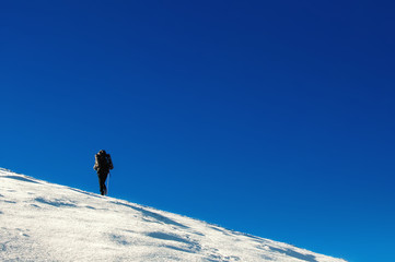 Hiker climbs to the top of the mountain