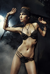 Woman in fantasy metallic lingerie