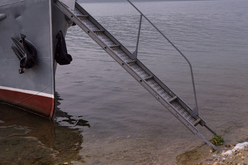 Gangway between the deck of the ship and the shore. Lake Baikal. Russia.