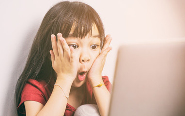 Little Asian girl is shock with what she see on the Internet. Parent should be more careful on how their kid using the computers.