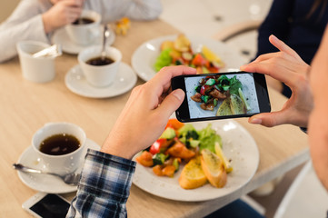 Close-up Man's hands Taking Picture Of Food With Mobile smart Phone