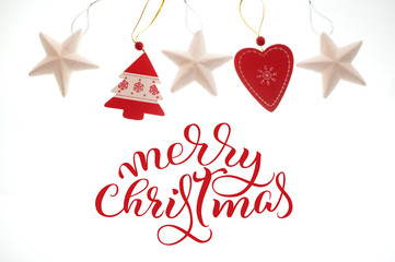 Festive Toys isolated on white background and text Merry Christmas. Lettering calligraphy