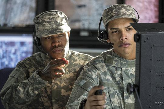 Two drone operators making a hard strike call