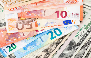 Money background from euro banknotes and american dollars