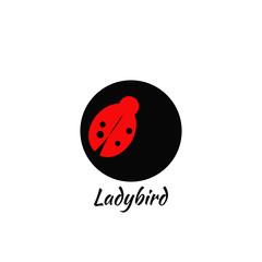 Ladybird logo on a bllack circle. Idea for a company name.