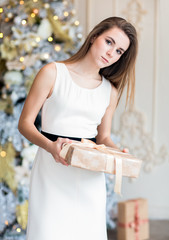 Young woman on christmas background