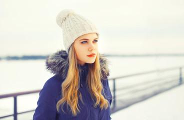 Fashion winter portrait blonde woman wearing a jacket and knitte