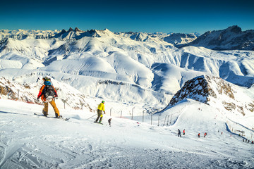 Skiers skiing downhill in French Alps,Alpe d Huez,Europe
