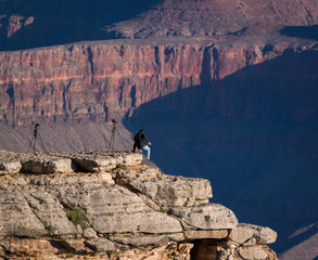 Reckless photographer walking on the edge in the Grand Canyon, Arizona, USA