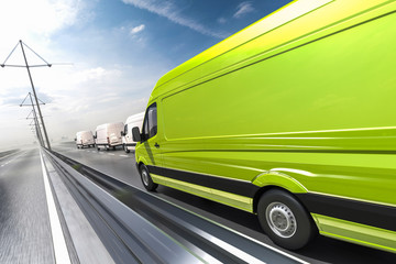 Green van in motion on a colorful background