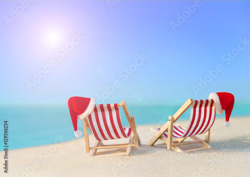 Two striped red white sunloungers with christmas santa for Hot vacation spots for couples