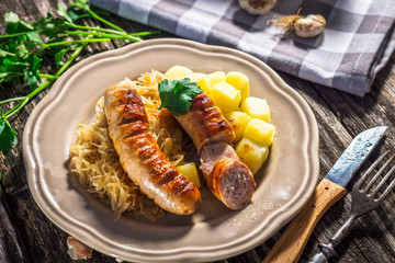 Grilled sausages,  potatoes and sauerkraut