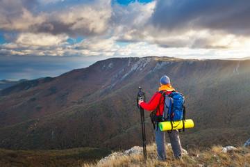 Nature photographer takes photos on mountain