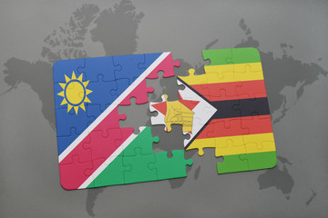 puzzle with the national flag of namibia and zimbabwe on a world map