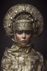 Woman in decorative kokoshnik head wear