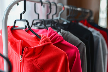 Warm colored sport jackets hanging at a fashion store