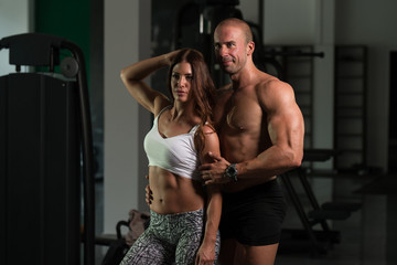 Healthy Young Couple Flexing Muscles