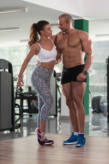 Young Sexy Fitness Couple Posing In Gym