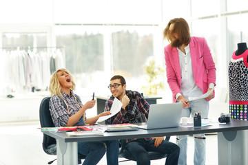 contemporary fashion designer with the creative team in the Studio