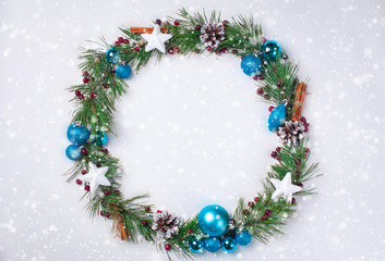 Christmas decoration wreath pine branches cones Christmas balls toys white background
