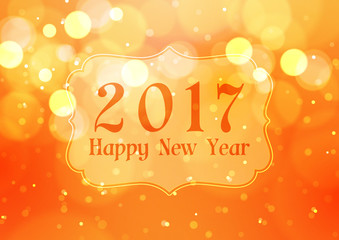 Happy New Year 2017 with Bokeh Lights on Orange Background