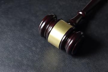 Law gavel on black leather