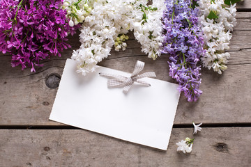Background with fresh aromatic lilac flowers  and empty tag on v