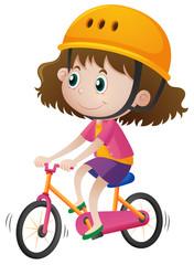 Girl wearing helmet when riding bike