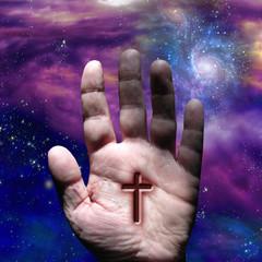 Cross on hand under stars