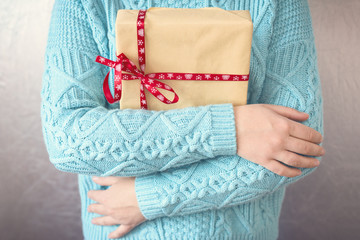 Christmas gifts. Merry christmas. Knitted mittens. Knitted dress. Box with gifts Present. Toned image