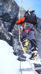mountain climber on a rope ladder on the Doldenhorn in the Swiss Alps