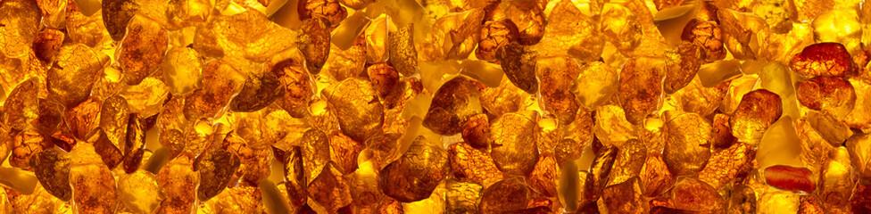panoramic closeup baltic amber stones rectangular lie on a flat surface