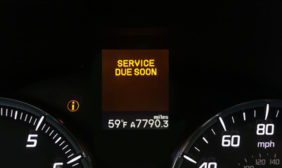 Auto service due soon indicator on dashboard with copy space.