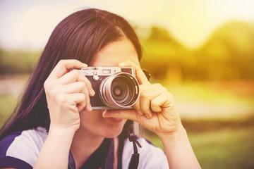 Female photographer with professional digital camera. Retro style