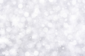 Abstract white bokeh with snowfall background