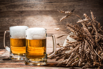 Couple of beers on empty wooden background