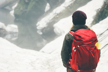 Traveler with backpack hiking alone Travel Lifestyle adventure vacations concept outdoor snow winter forest on background